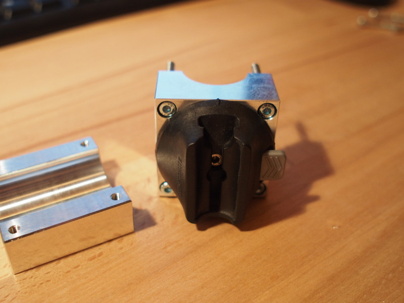 The new bracket with bolts and lock socket